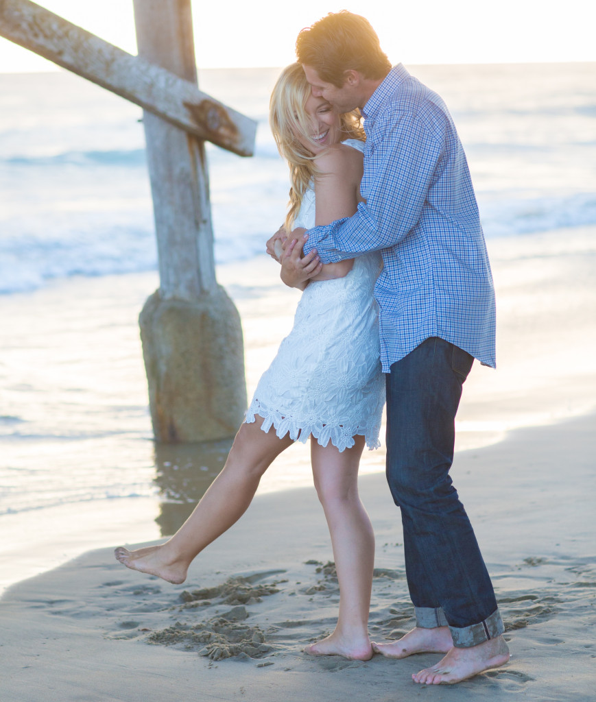 beach dancing, engaged couple