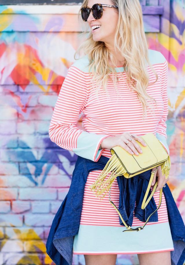 Sail to Sable striped dress and Henri Bendel fringe handbag.