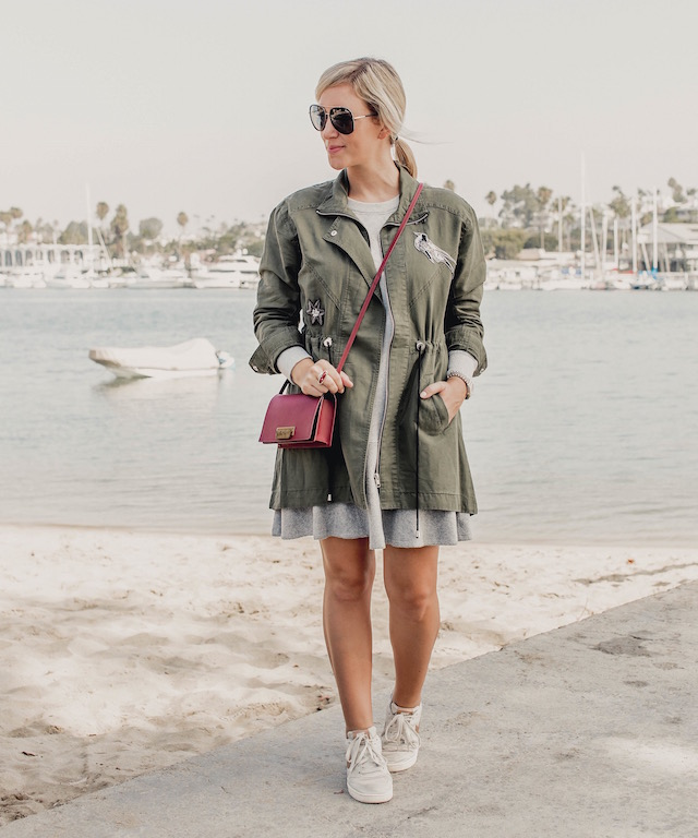Fashion and lifestyle blogger Nikki Prendergast of My Style Diaries in the cabi Flashdance dress and Hanson Anorak with Nike sneakers.