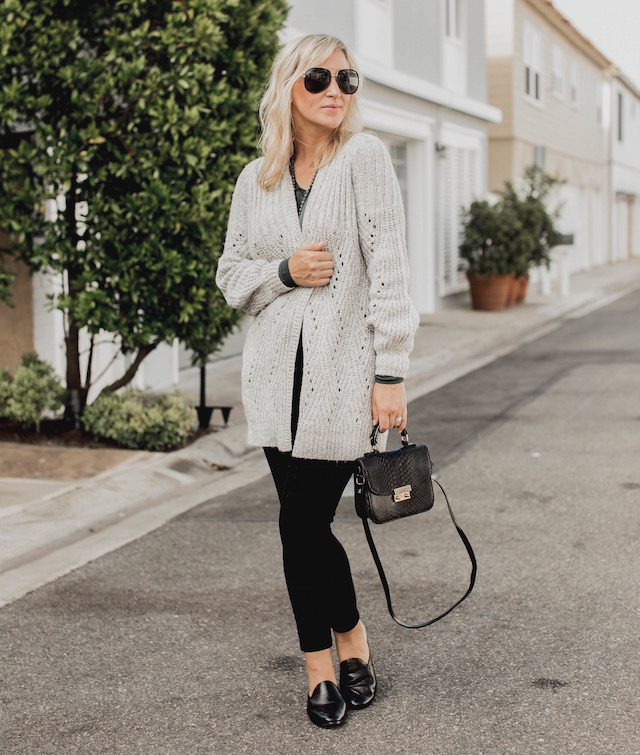 Fashion and lifestyle blogger Nikki Prendergast of My Style Diaries in Banana Republic skinny jeans and loafers and an oversized cabi cardigan.