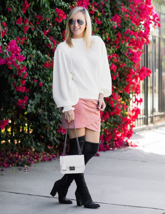 Fashion blogger Nikki Prendergast of My Style Diaries in a statement sleeve sweater, a suede skirt, and over-the-knee boots.