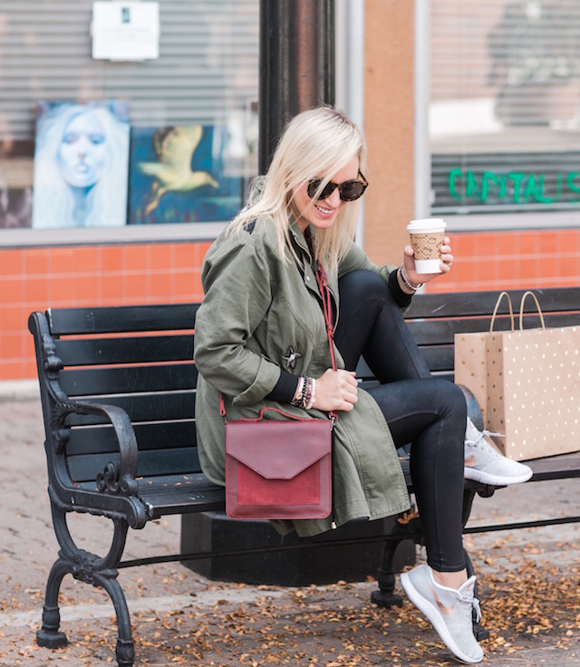 Spanx faux leather leggings, cabi jacket, crossbody bag, and Nike sneakers from Famous Footwear