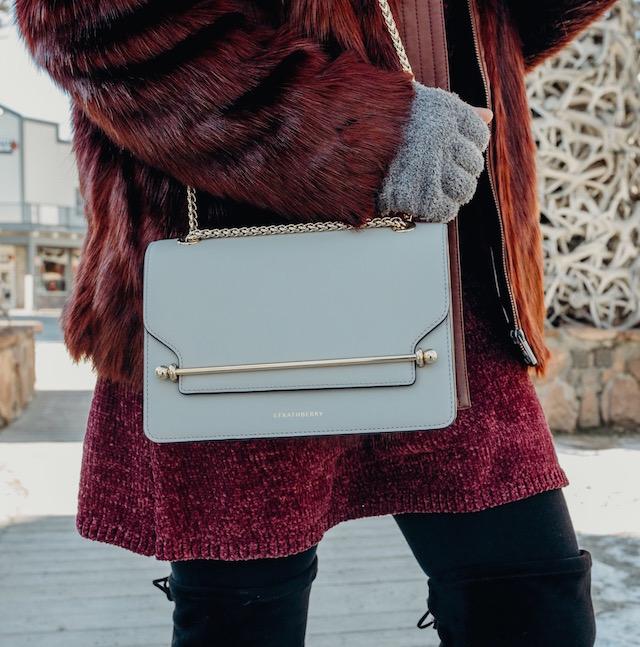 burgundy faux fur + Strathberry handbag